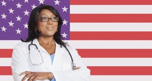 Female doctor in-front-of US flag